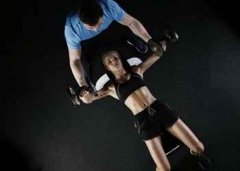 woman with a male personal trainer in Burnley